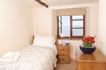 The single bedroom is on the ground floor and once again has sea views.
