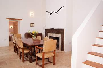 The entrance hall and grand dining-table - a double height room with stairs leading up to the open plan living space on the first floor.