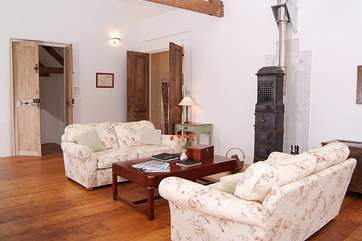 This welcoming cottage has an open plan living area with a Scandinavian wood-burner - there is a second sitting-room too.