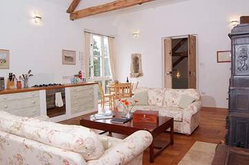 The living area on the first floor has plenty of room for the kitchen, a breakfast-table and two sumptuous sofas either side of the wood-burner.