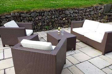 The patio has inviting seating, a table-tennis table and a stone barbecue area built into the wall at the edge of the garden. A disposable barbecue is kindly provided for you.