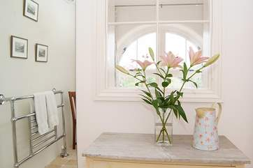 A pretty internal window from the bathroom to the dressing-room is a lovely feature.