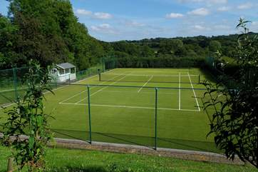 A path from the parking-area next to the cottage takes you to this fabulous tennis court.