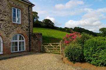 The cottage has a lovely terrace style garden at the front as well as a lawned garden and patio at the back.