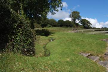 The main garden area is at the back of the cottage, complete with a little stream!