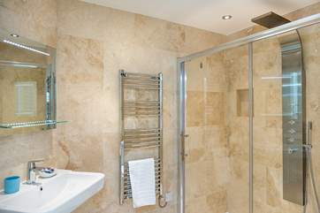 The en-suite shower room for Bedroom 2 with a column drench head shower