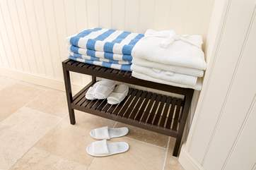Fluffy robes, towels and slippers for when using the hot tub
