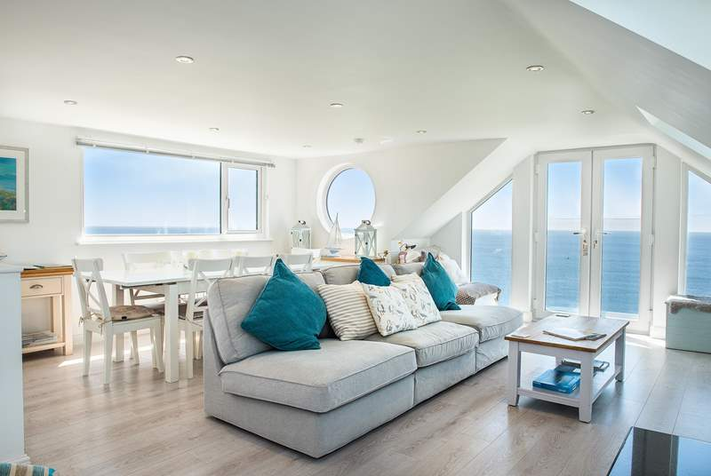 The open plan living room encompasses all of the first floor making the most of those sea views