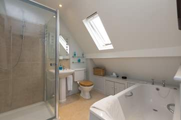 As well as this family bathroom, with shower and bath, there is a downstairs cloakroom for additional convenience.