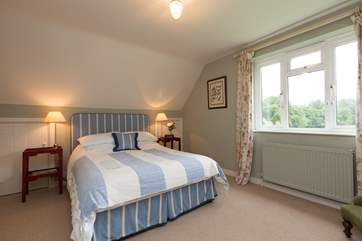 Upstairs there are two bedrooms - this is the double with its super comfy king size bed and views across the countryside.