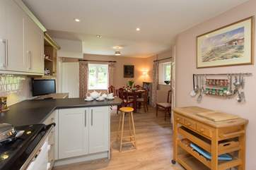 There is an open plan kitchen/dining room with garden views.