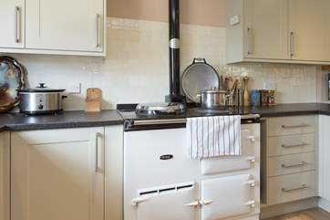 The Aga is the focal point of this lovely kitchen, adding that lovely extra warmth too.