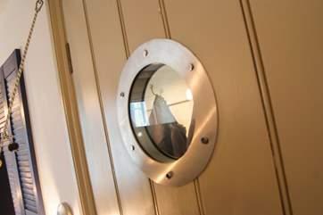 Porthole windows continue the nautical theme.