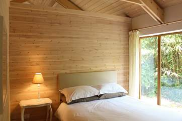 The double bedroom with king-size bed and with the roof open to the rafters above there is an increased feeling of air, light and space.