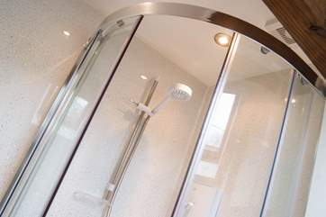 Glittery shower boarding on the walls adds a touch of fun.