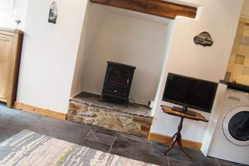A wood-burner effect electric stove adds warmth and a focal point (without the effort!).
