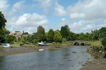 The ancient bridge that crosses the river.