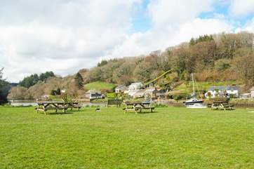 Enjoy a cream tea on the village green watching the comings and goings along the river