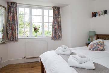 The master bedroom looks out towards the village and the little nature reserve across the river where all are welcome.