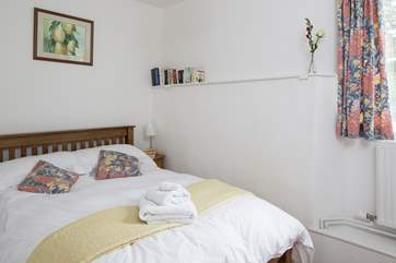 This bedroom has a double bed and looks out over the fields.
