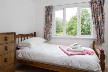 This is the single bedroom overlooking the garden. The cottage only accommodates four guests but gives you the flexibility of three bedrooms.