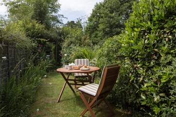 The cottage has a pretty sheltered garden where you can sit and listen to the river just across the little lane.