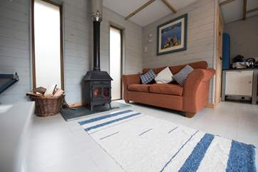 With a comfortable sofa next to the wood-burner keeping you toasty and warm during the cooler months.