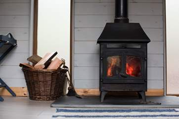 The wood-burner will keep you lovely and warm on those out of season months (logs are inclusive).