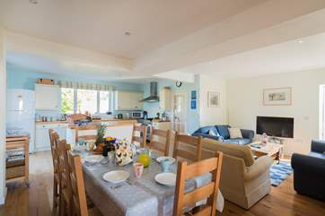 The spacious open plan kitchen/dining-room has space for everyone for cooking, eating and relaxing and a handy shower-room in the corner too.