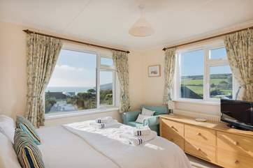 The dual-aspect master bedroom has wonderful sea views and is flooded with light.