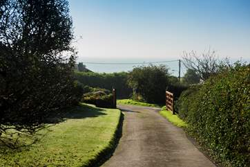 The private driveway leading back to the lane and the beach beyond.