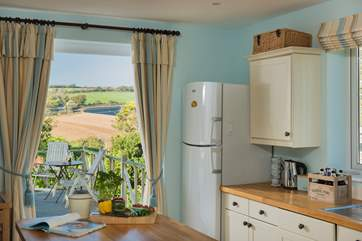 French doors open from the kitchen straight onto the decking with views of the hills beyond.