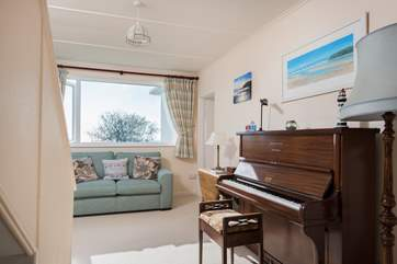 Relax in the hallway whilst tickling the ivories before breakfast.