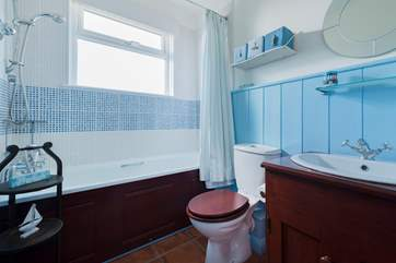 The family bathroom with bath and shower.