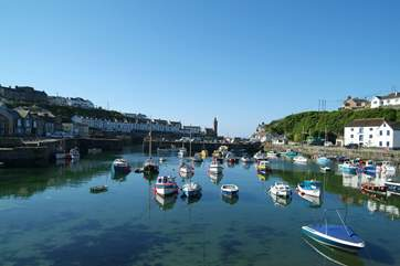 The pretty harbour at Porthleven is a ten minute drive away towards the Lizard.