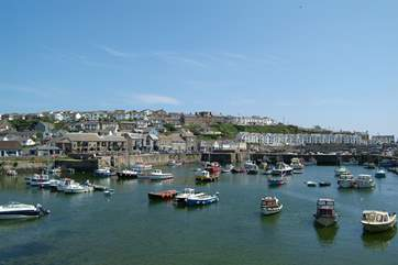 Not only can you watch the boats bobbing in the harbour but there are lots of great places to eat, drink and shop.