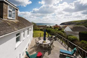 A birds eye view from the decking down to the sea beyond,