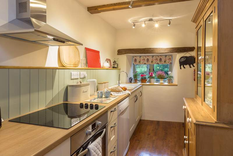 Step down to the galley style kitchen which is really well equipped.
