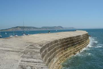 The iconic Cobb at Lyme Regis with Golden cap in the background.