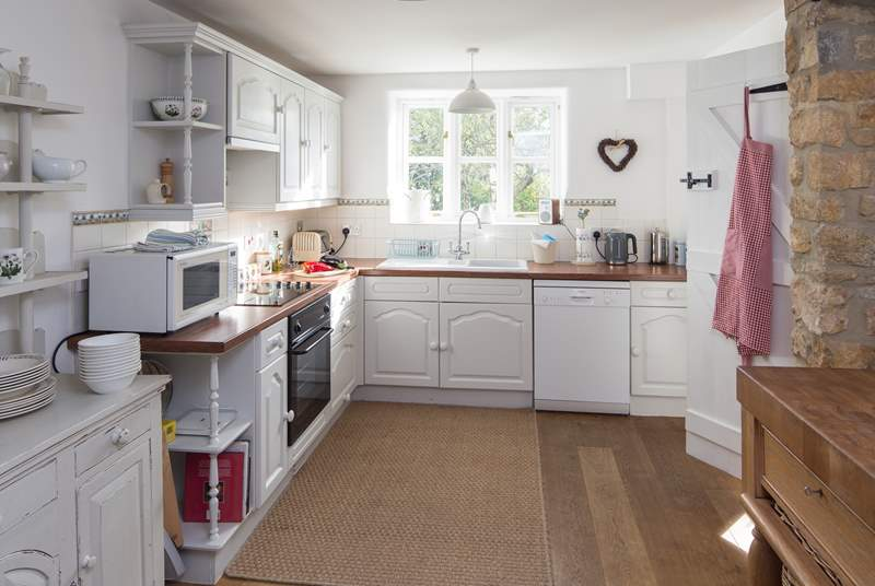 The spacious well-equipped kitchen has all that you need to prepare a feast.The kitchen is being replaced in early 2019 with a  deVOL kitchen.