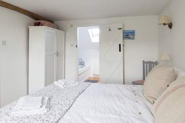 The master bedroom has a generous 5ft bed with gorgeous linens and an en suite bathroom.