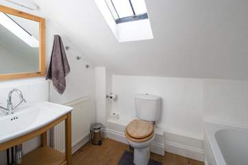 The spacious family bathroom has a shower over the bath.