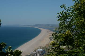Chesil beach, taken from the Isle of Portland looking back along the Jurassic Coast towards Lyme Regis in the far distance.