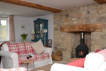 The sitting/dining room is a very sociable space with a cosy woodburner, where all the family can be together.