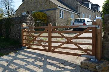 These electric gates at the entrance to the farm  are activated by driving onto a magnetic circuit under the concrete which reacts upon a car driving onto it. The gates will close automatically after