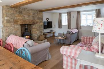 The open plan sitting room/dining room has three sofas to choose from and a cosy wood burner. The sitting room is being updated early in 2019.