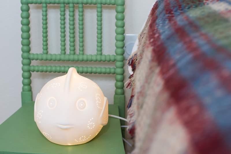 Children will love the ceramic fish lamp.