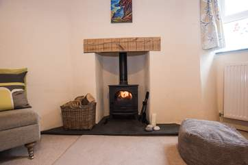 This little wood-burner keeps toes toasty warm!