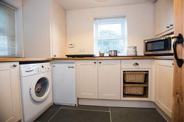 The separate utility-room is spacious and offers a lot of extra equipment.
