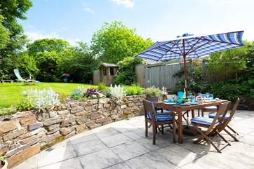 The spacious patio at the rear of the cottage is accessed from both sitting-room and kitchen..